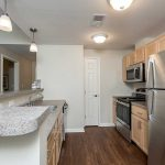 Kitchen of a one bedroom apartment at The Legends at Whitney Town Center